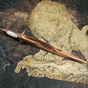 Swank 1940s gold toned dagger tie bar!